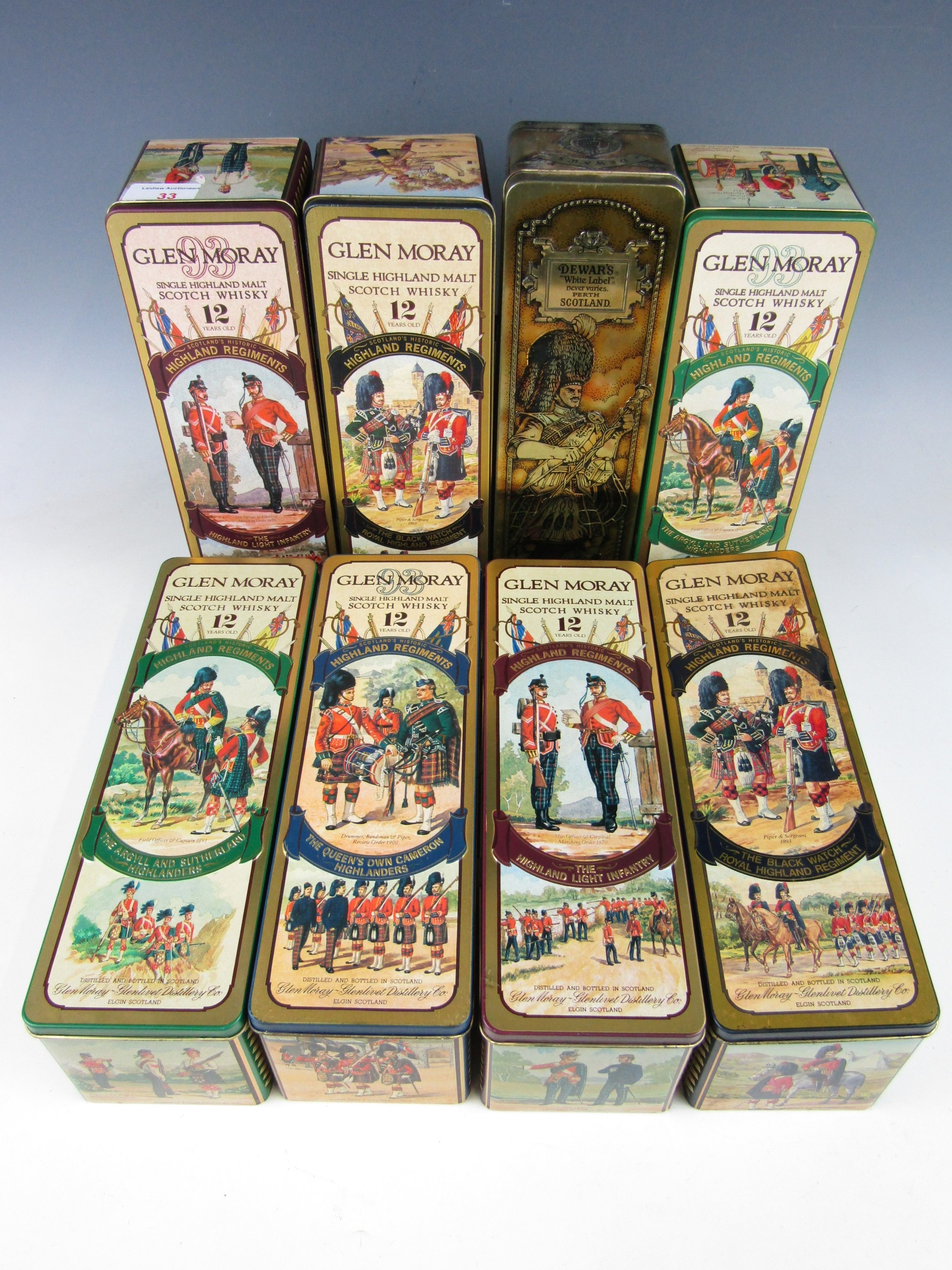 Lot 33 - A collection of eight Scottish military themed whisky decanter tins from Glen Moray and Dewars