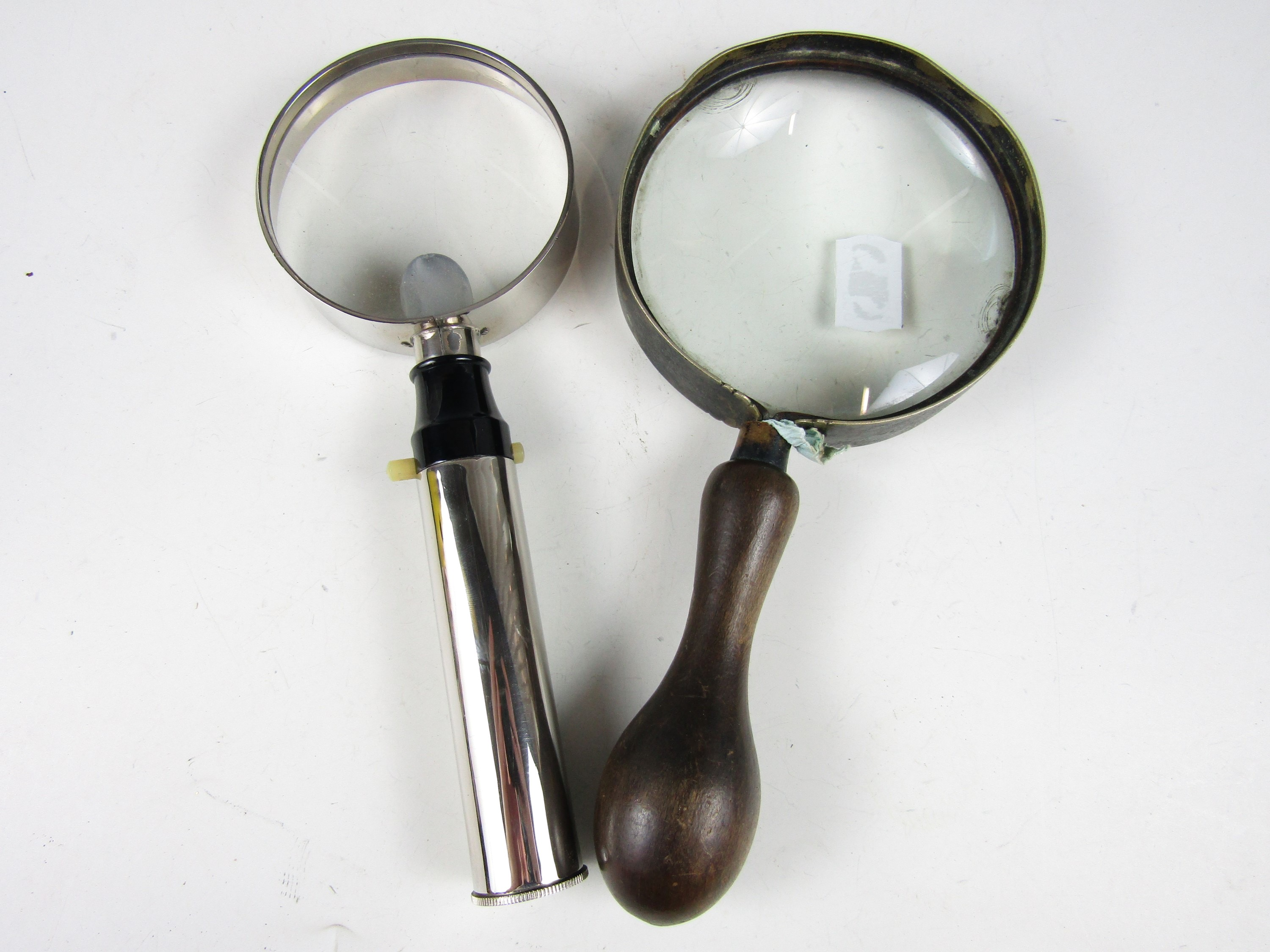 Lot 48 - A late 19th / early 20th century magnifying glass together with an Enbeeco Magnalite