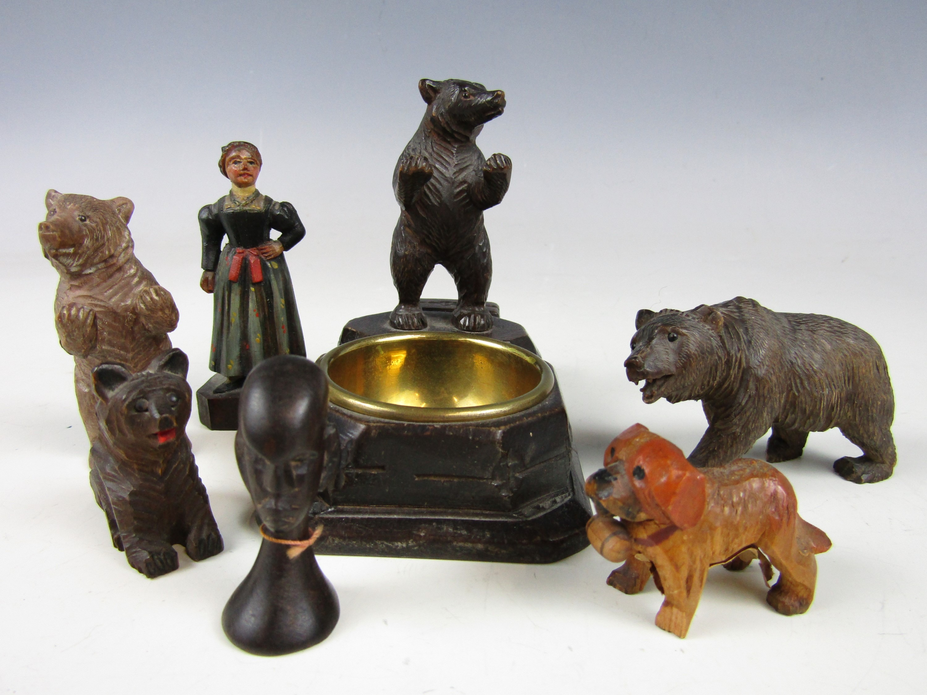 Lot 18 - A Black Forest carved ashtray from Engelberg, together with sundry carved bears and a hand made