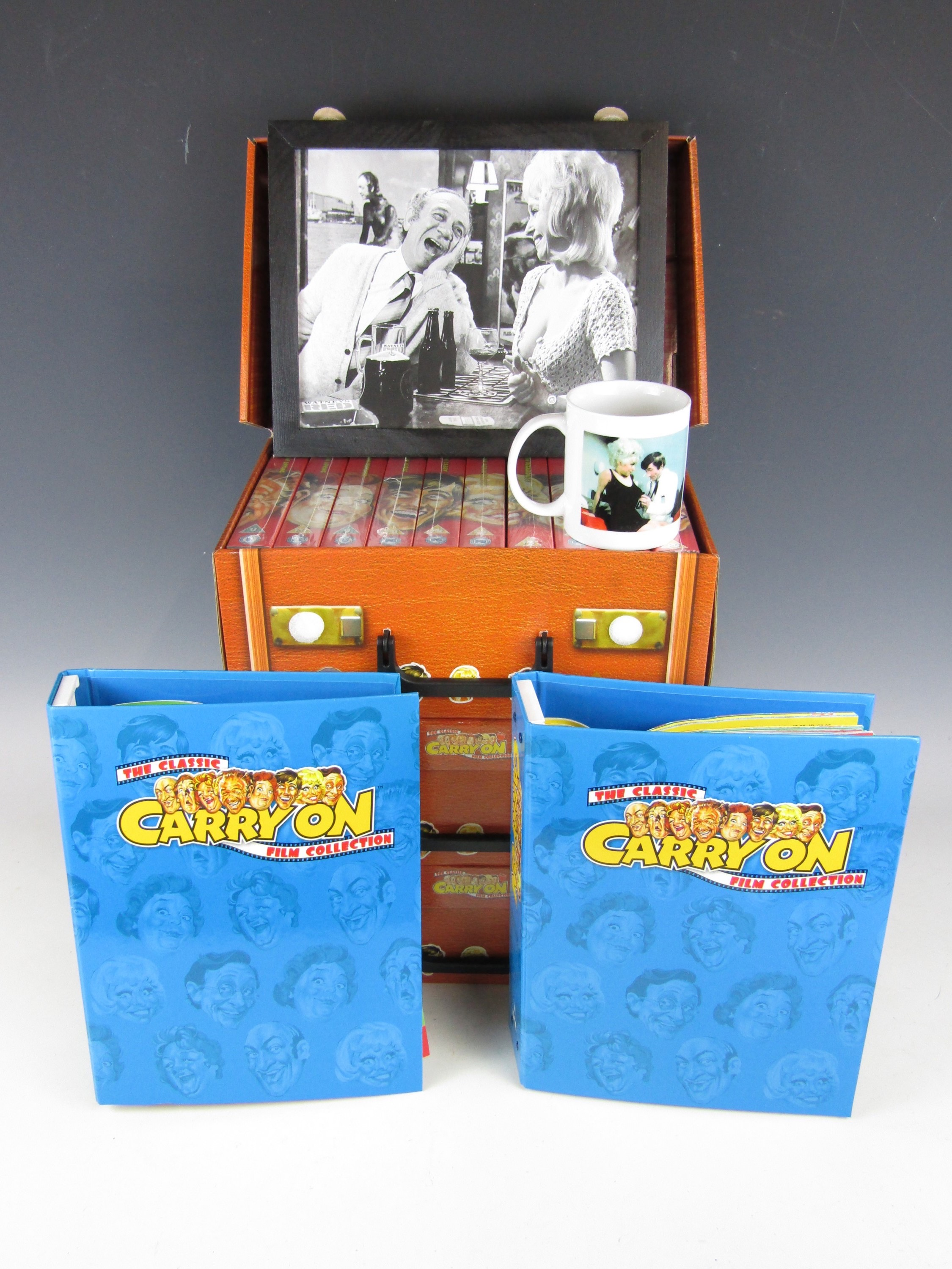 Lot 20 - A large quantity of Carry On memorabilia including three cased set of VHSs, two folders of