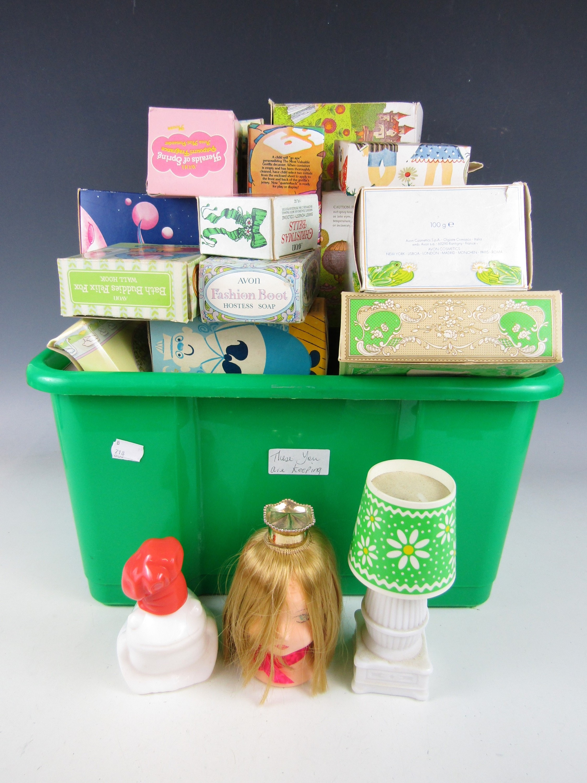 Lot 16 - A large quantity of Avon boxed bottles including children's themes, pomanders etc