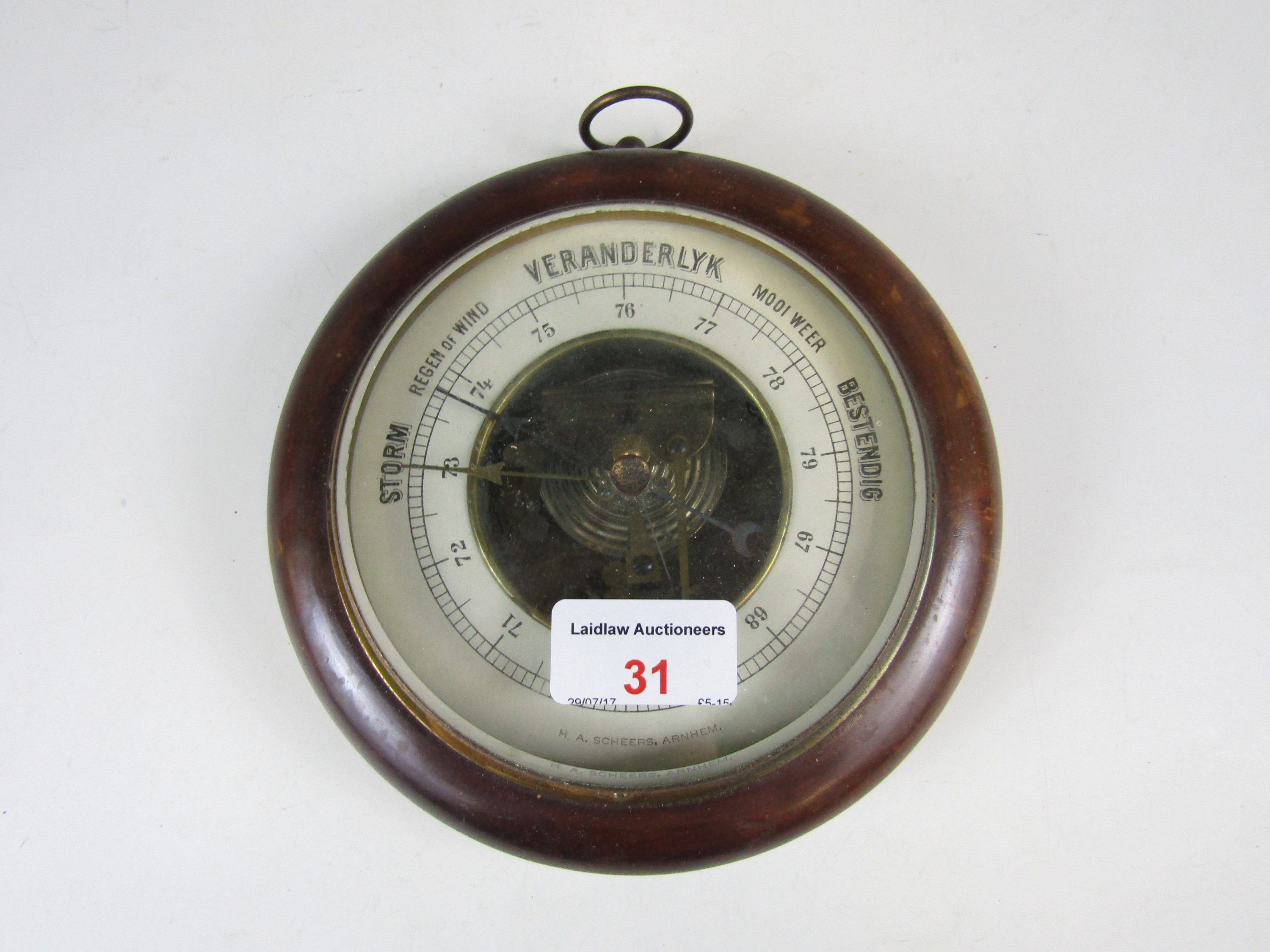 Lot 31 - A Dutch wheel barometer