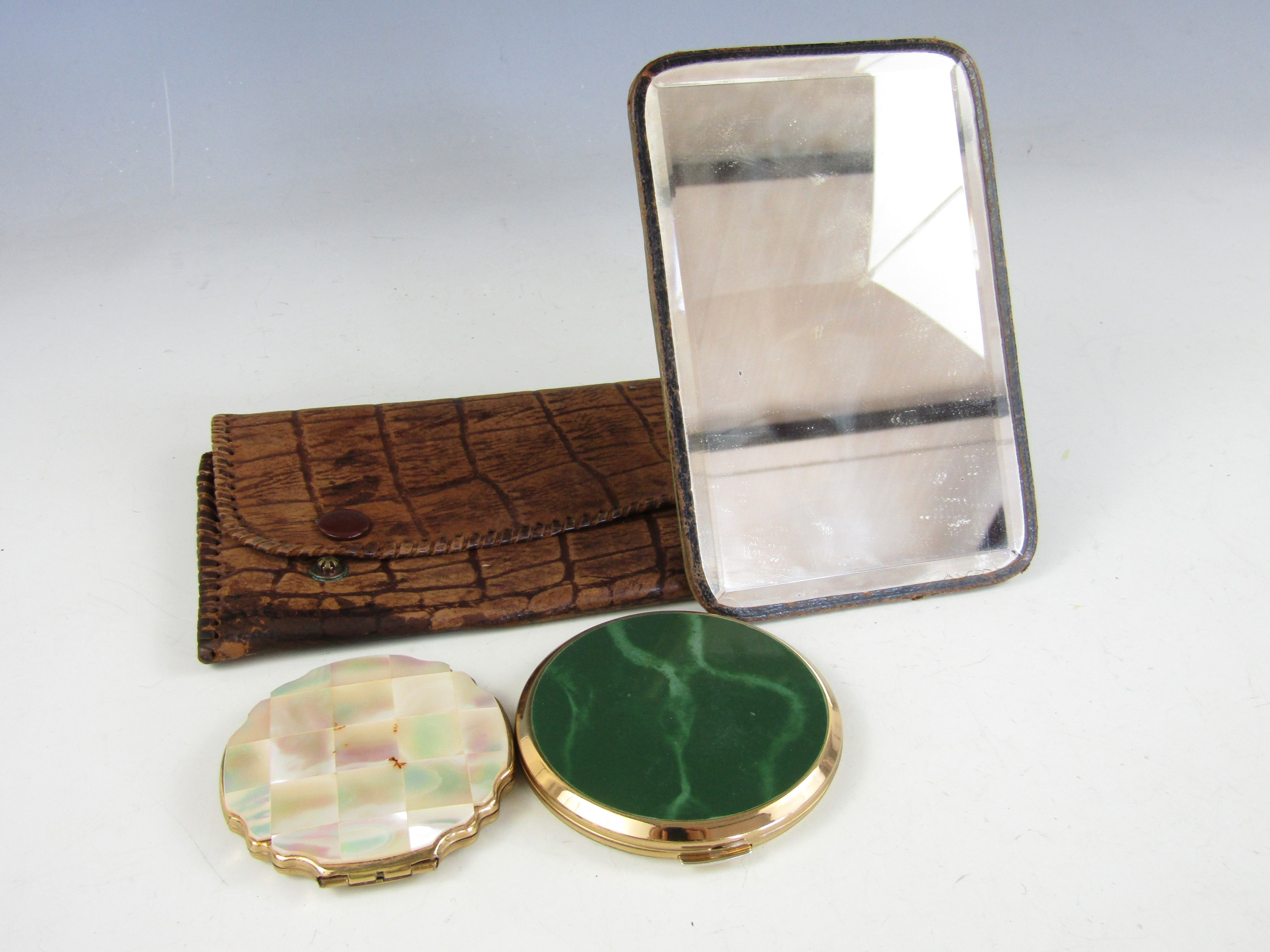 Lot 47 - Two vintage Stratton compacts together with a cased dressing mirror