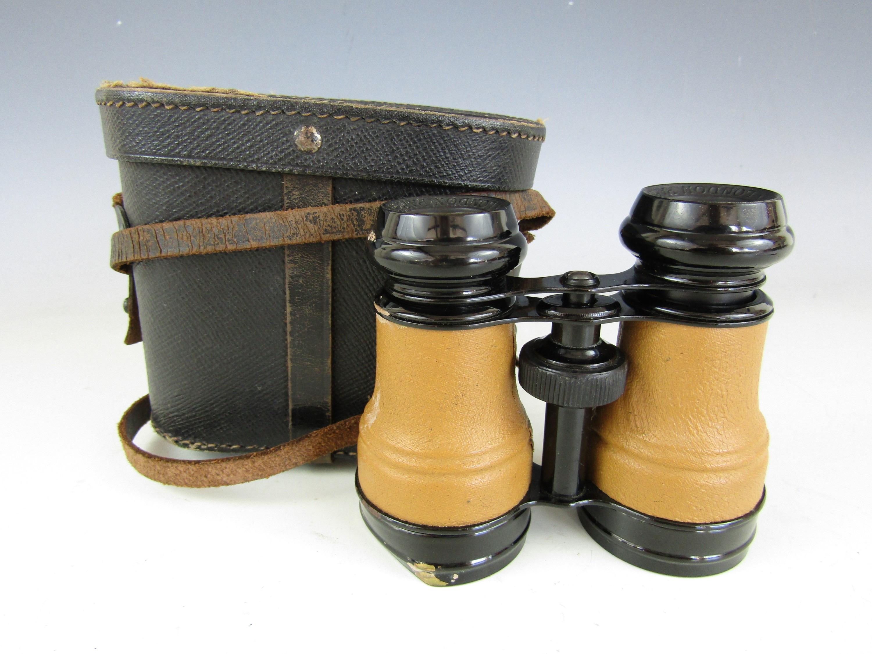 Lot 27 - A cased pair of 'The Aero Club London Paris' binoculars (a/f)
