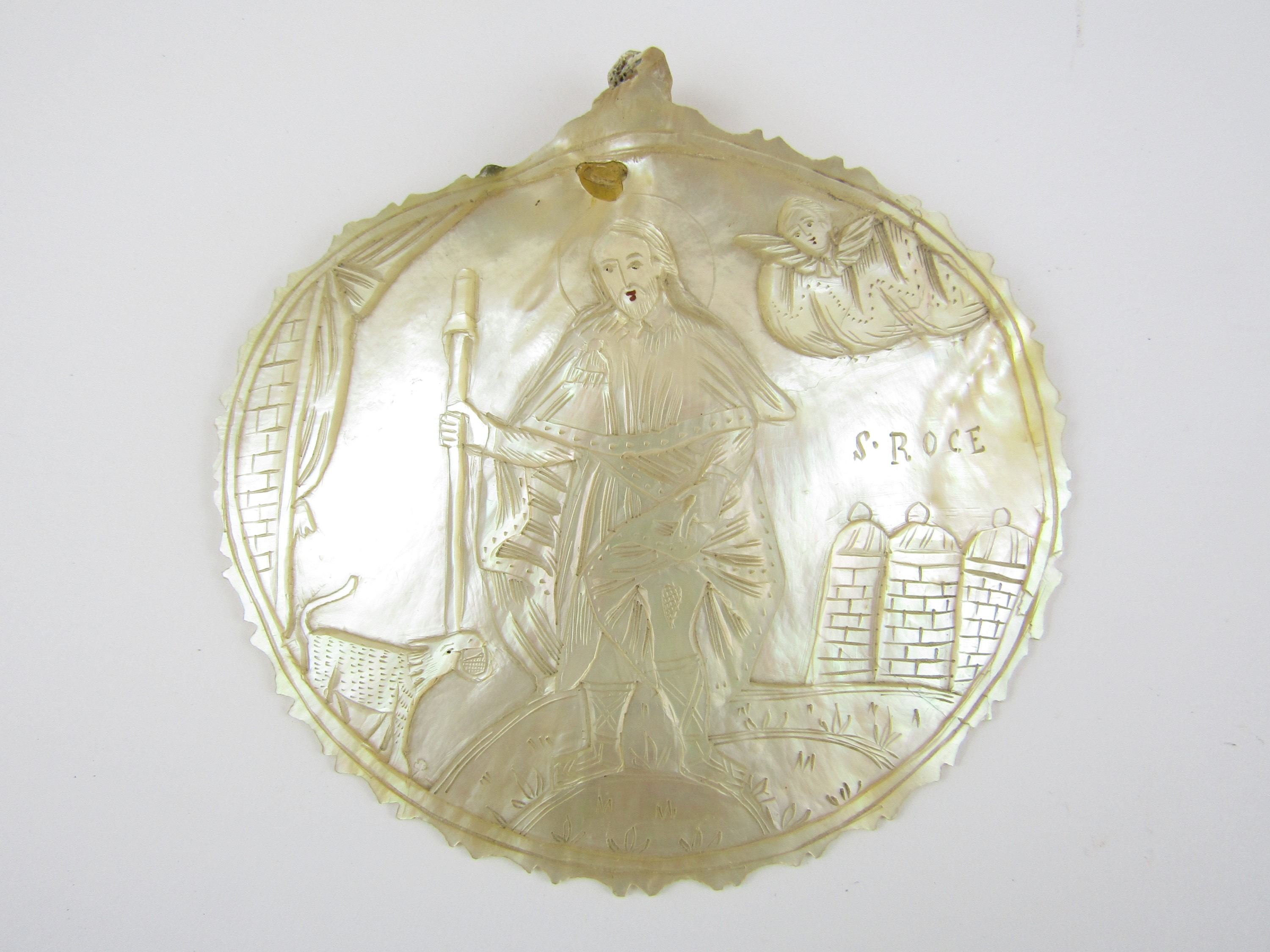 Lot 57 - A religious engraved mother of pearl plaque