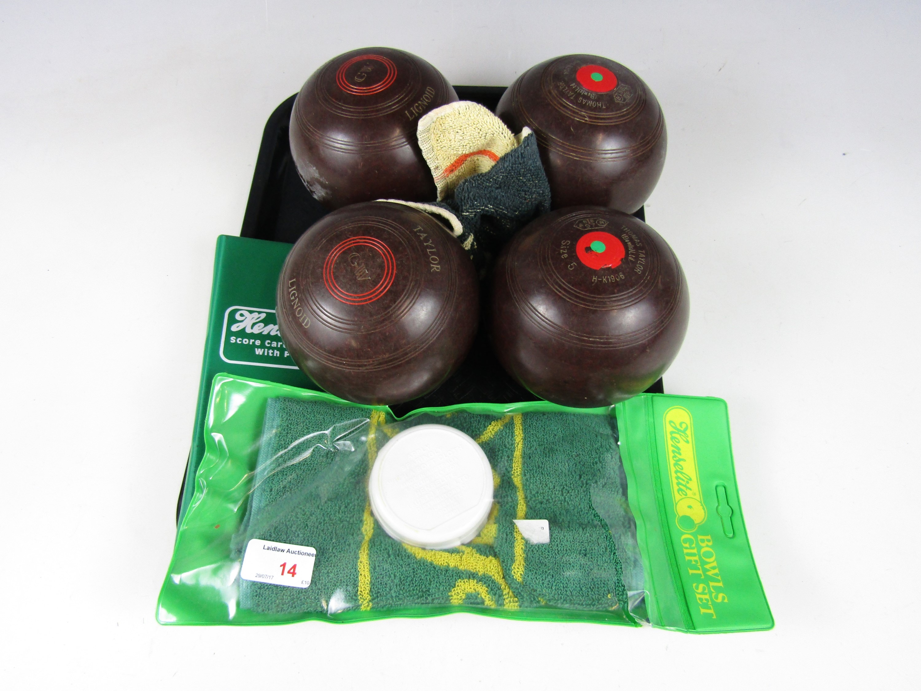 Lot 14 - A set of four Bakelite Thomas Taylor bowls and bowling accessories