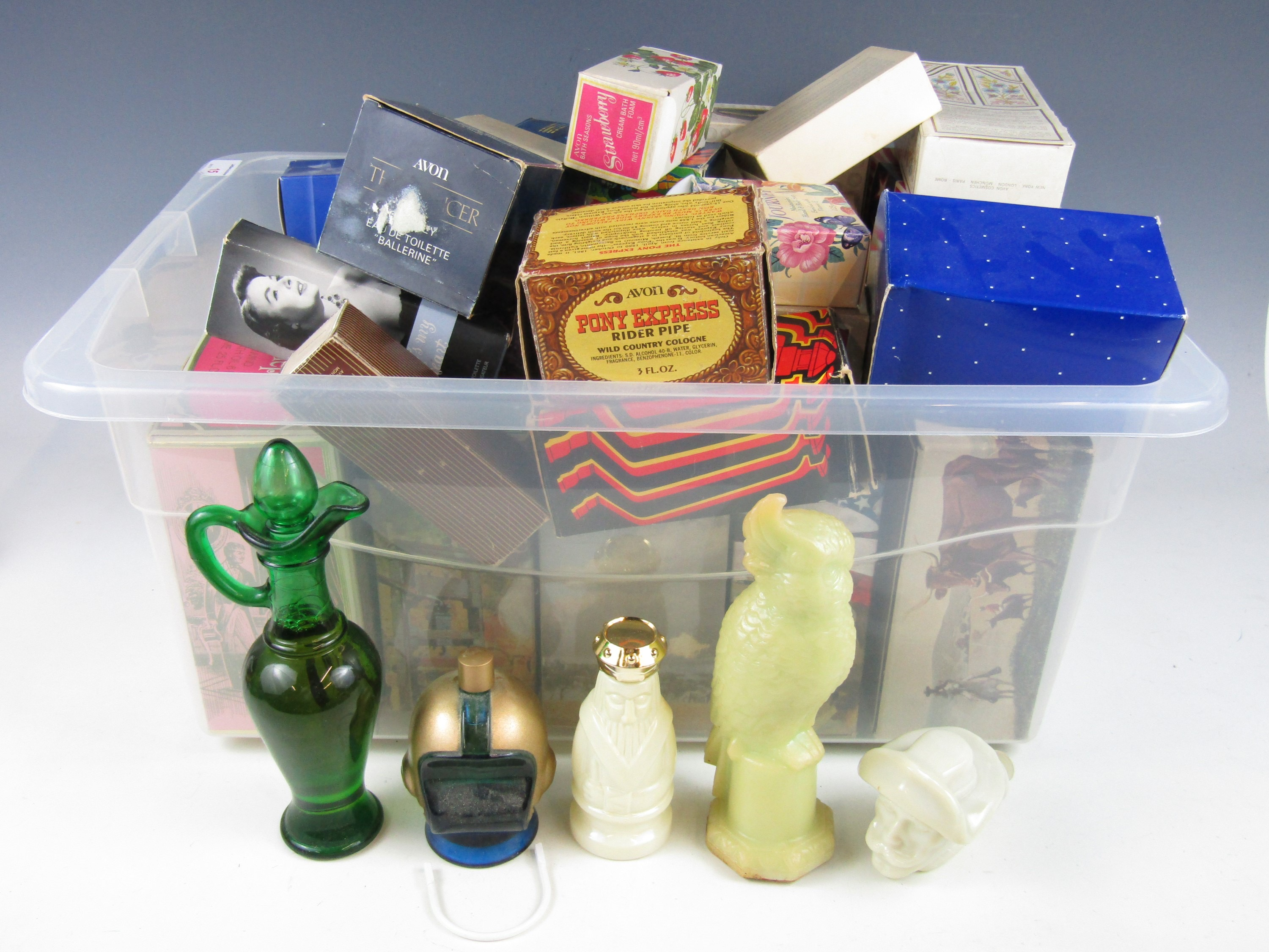 Lot 15 - A large quantity of vintage Avon boxed bottles including wild west, sporting, animals and