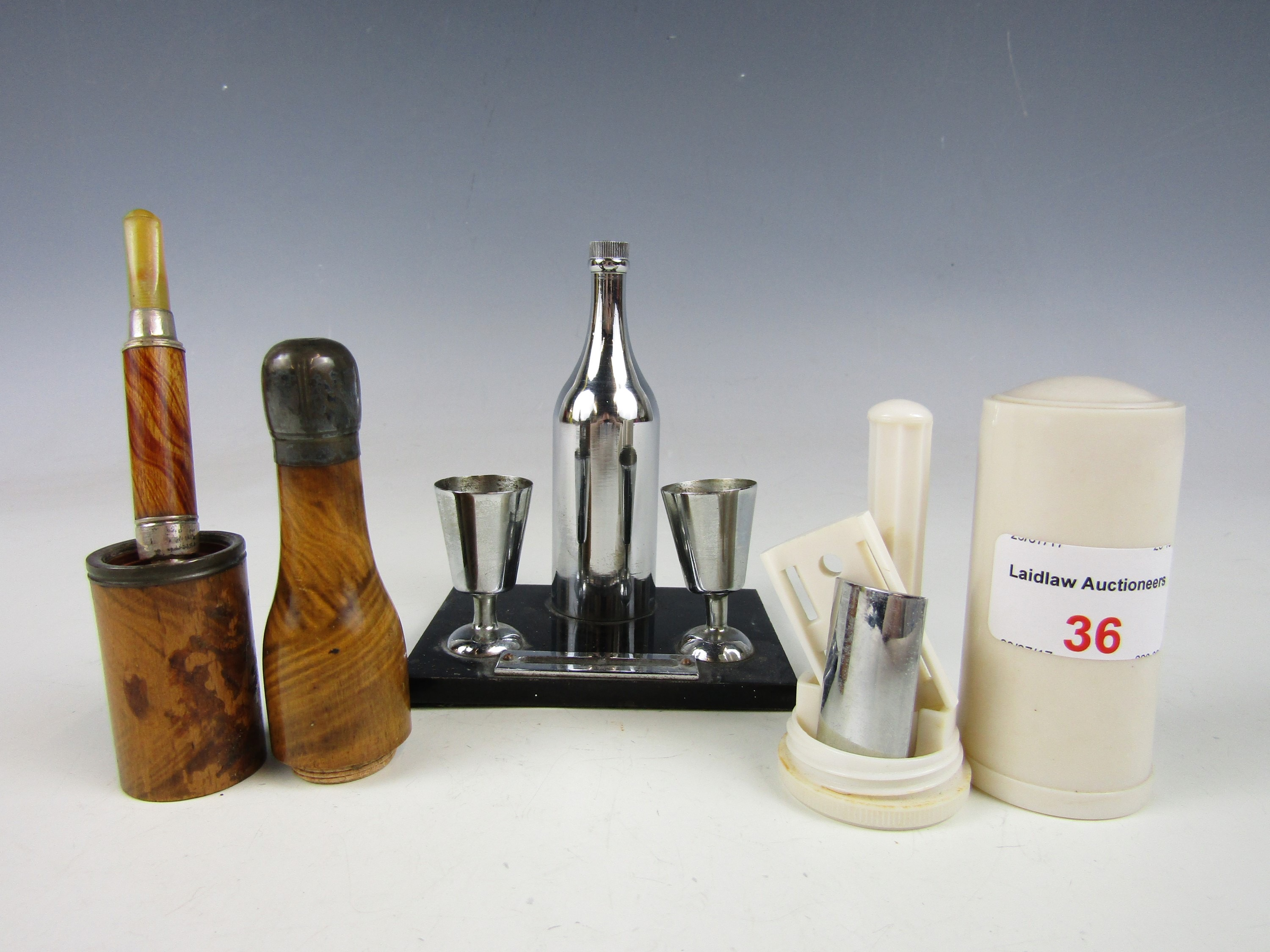 Lot 36 - Sundry kitsch collectibles including an Art Deco novelty table cigar lighter modelled as a bottle
