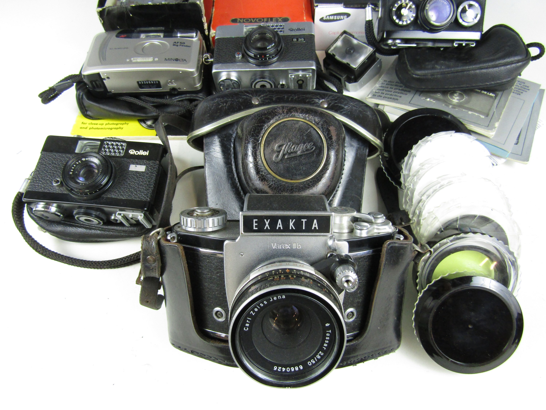 Lot 52 - A quantity of cameras including a Samsung S1070 digital camera, Hoya photographic filters, compact
