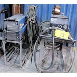 MILLER XMT 350 CC/CW WELDER, S/N LG240073A W/ MILLER 22A WIRE FEEDER, CABLES & CART