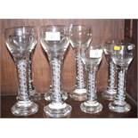 A set of five opaque twist stem goblets, on weighted bases, and three smaller similar goblets (small