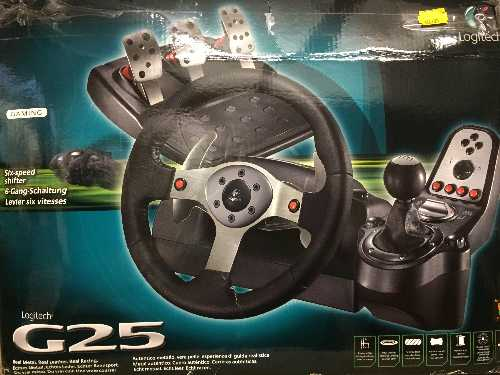 Lot 5 - A boxed Logitec G25 steering wheel and foot pedal PC accessory