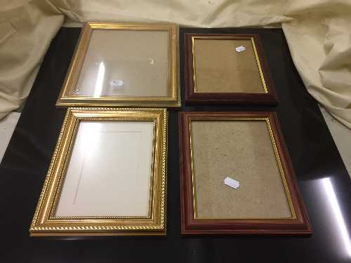 Lot 31 - A boxed artist's easel and a box of photo frames