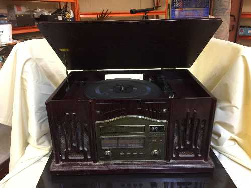 Lot 14 - A retro style table top record player and a box of LP records