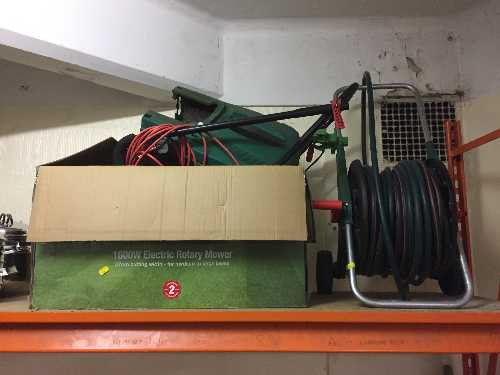 Lot 30 - A Qualcast electric mower with box and lead,