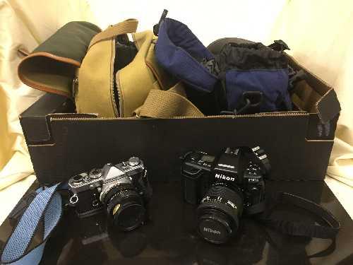 Lot 3 - A box of camera bags, Olympus OM-1 camera with lens, Nikon F90X camera, Sony cam corder,