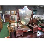 Mahogany framed shield shaped toilet mirror on base with drawers either side. Estimate £40-60.