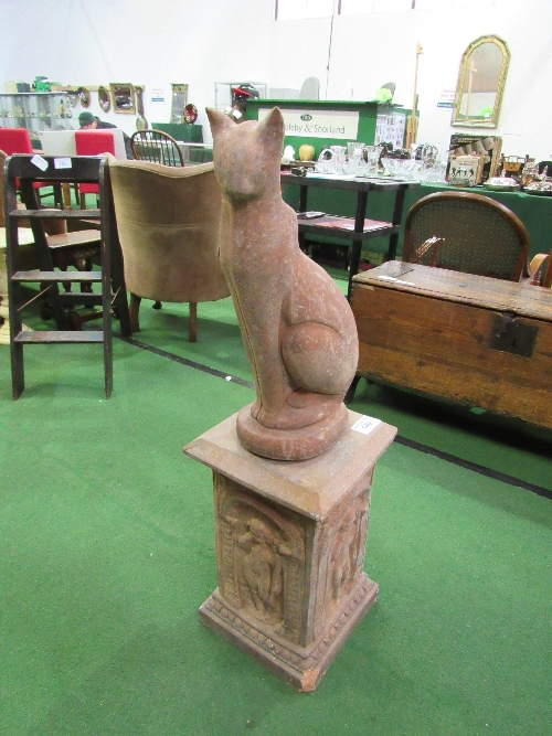Lot 140 - Red coloured stone-effect cat figurine in contemporary style on square red coloured concrete plinth,