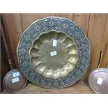 Large circular brass tray with Middle Eastern design, approx. 77cms diameter. Estimate £30-50.