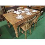 Pine kitchen table on turned legs, 153cms x 91cms x 77cms, together with 4 Windsor chairs