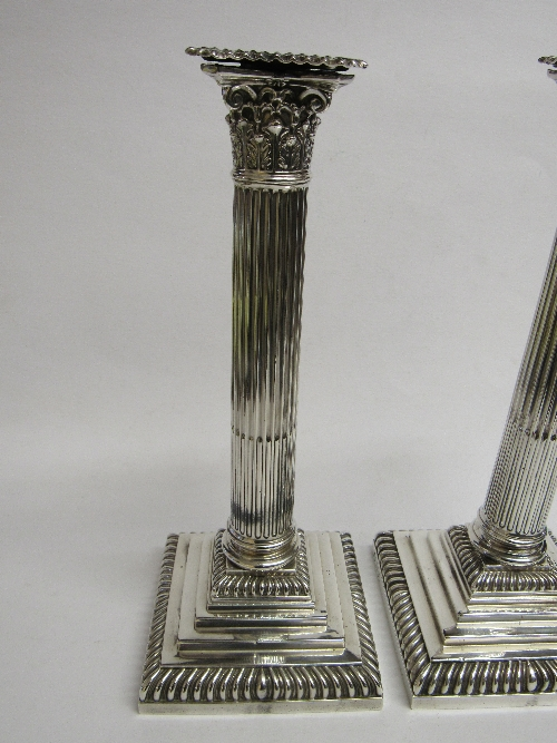 Lot 352 - A pair of silver candlesticks by Hawksworth Eyre & Co Ltd, Sheffield, 1893 in the shape of