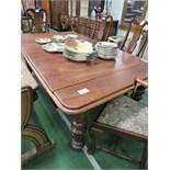 Mahogany wind-out dining table on heavy turned legs c/w handle, 190cms x 100cms x 74cms. Estimate £