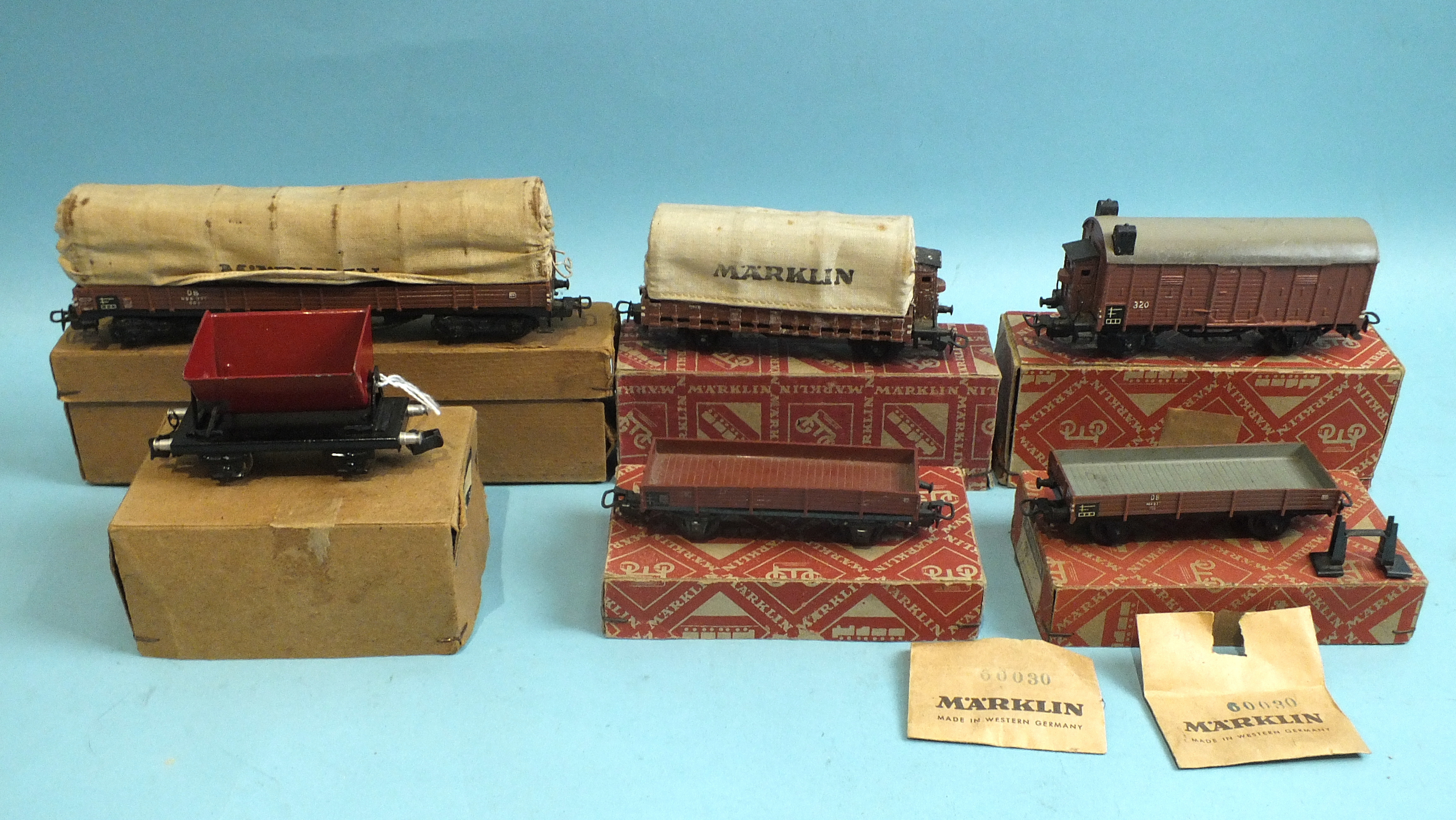 Lot 117 - Märklin HO gauge, 393C covered wagon, in original brown box, four other wagons in orange bicycle