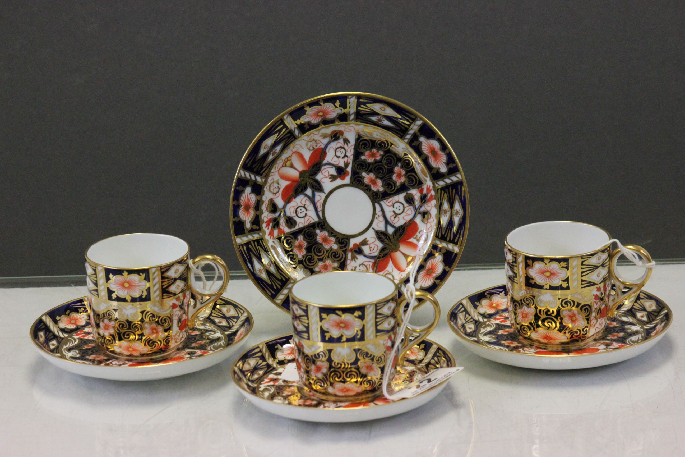 Lot 22 - Three Royal Crown Derby Imari pattern cup & saucers, one being a trio