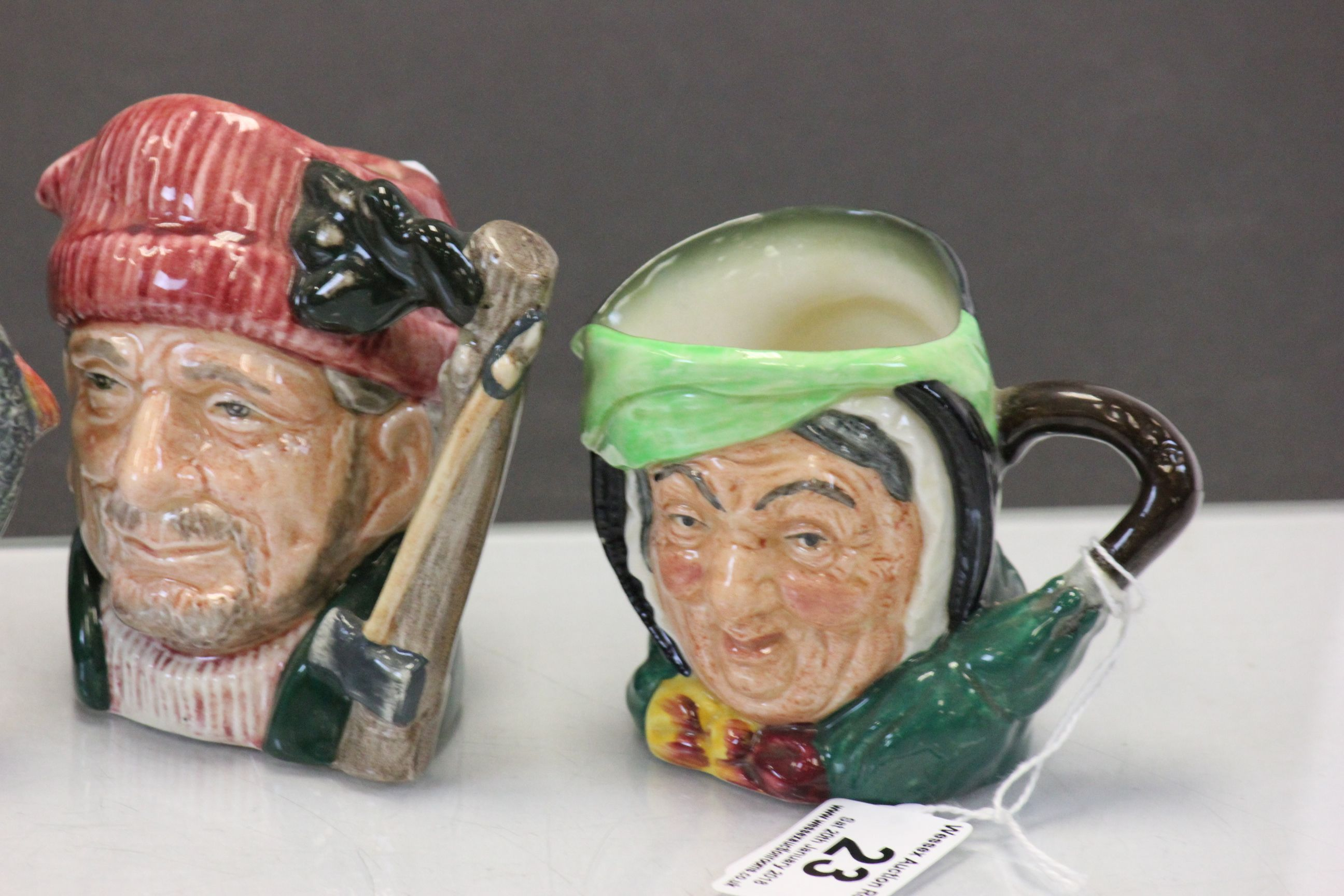 Lot 23 - Group of five small Royal Doulton Toby character jugs to include; Sarey Gamp, Auld Mac, The