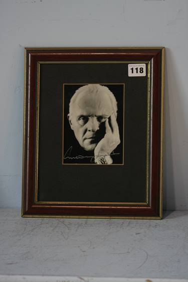 Lot 118 - Anthony Hopkins, signature in silver on black and white picture, framed