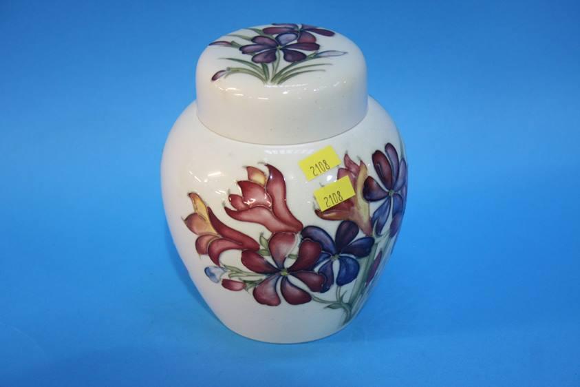 Lot 37 - A Moorcroft floral ginger jar and lid