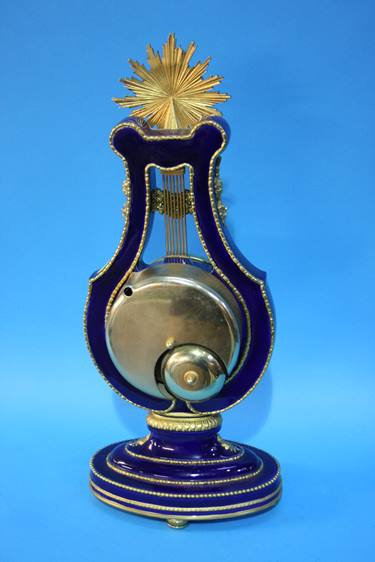 Lot 62 - A Victoria and Albert Marie Antoinette clock, an Anniversary clock and a Franklin Mint figure