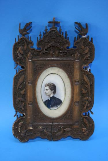 Lot 34 - Pair of heavily carved frames containing two overpainted portraits of a Lady and a Gentleman