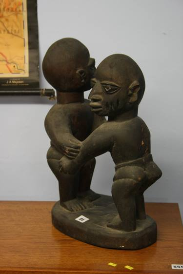 Lot 85 - Two carved African figure groups