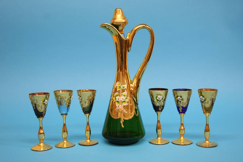 Lot 10 - A Continental coloured glass liqueurs set comprising gilt and enamelled decanter and six small