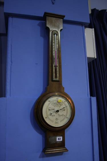 Lot 82 - A walnut cased barometer by Short and Mason, London