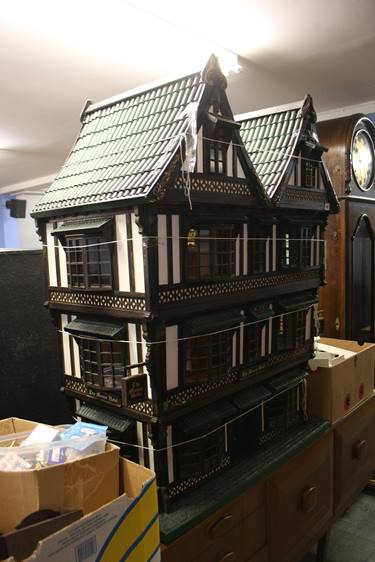 Lot 98 - A large dolls house 'The Manor Hotel' and accessor
