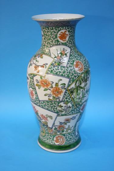 Lot 56 - An Oriental vase with panels, decorated with birds