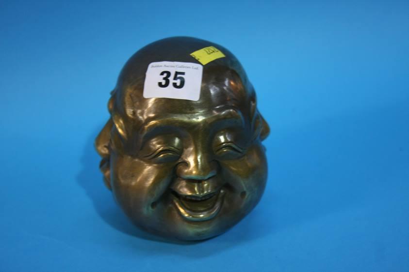 Lot 35 - A four faced brass Buddha's head