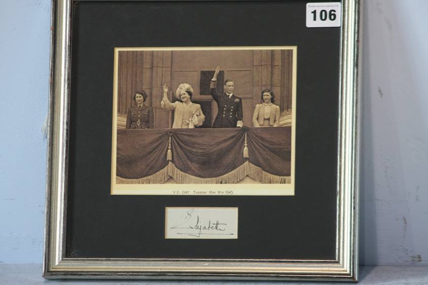 Lot 106 - Elizabeth the Queen Mother, fountain pen signature, mounted and framed with a picture of King George