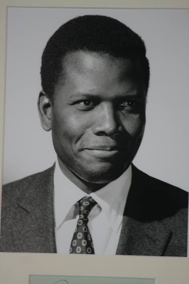 Lot 105 - Sidney Poitier, signature in fountain pen, dedicated 'To Paul', mounted and framed