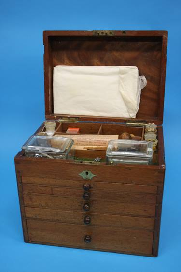Lot 8 - A 19th Century mahogany travelling Dentist's cabinet with rising top, opening to reveal a filled