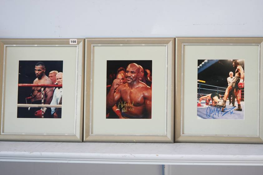 Lot 108 - Three framed photographs of boxing legends each signed, Mike Tyson, Evander Holyfield and Nigel