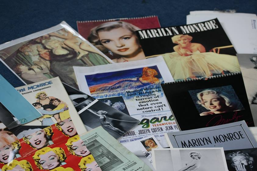 Lot 109 - Marylin Monroe memorabilia including calendars, postcards, pictures, stamps etc.