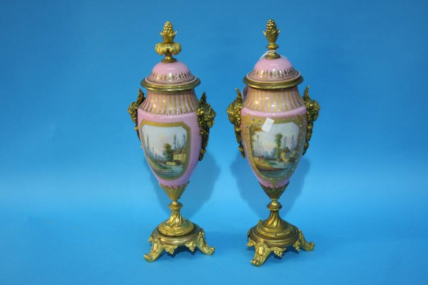 Lot 70 - A Continental gilt metal mounted three piece garniture, decorated with panels of landscapes and