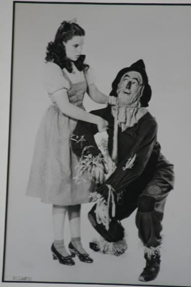 Lot 101 - The Wizard of Oz, Ray Bolger (The Scarecrow) signed photograph, framed together with Dorothy (Judy