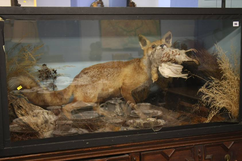 Lot 96 - Taxidermy study of a Fox with a grouse