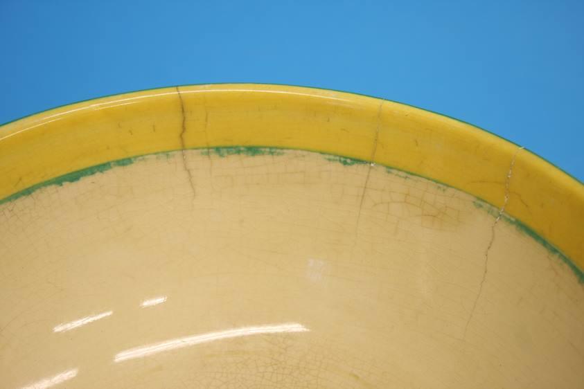 Lot 28 - A Clarice Cliff 'Crocus' pattern preserve pot, two 'Crocus' preserve pots (no lids), a 'Crocus'