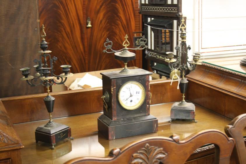 Lot 94 - A slate mantle clock and garniture