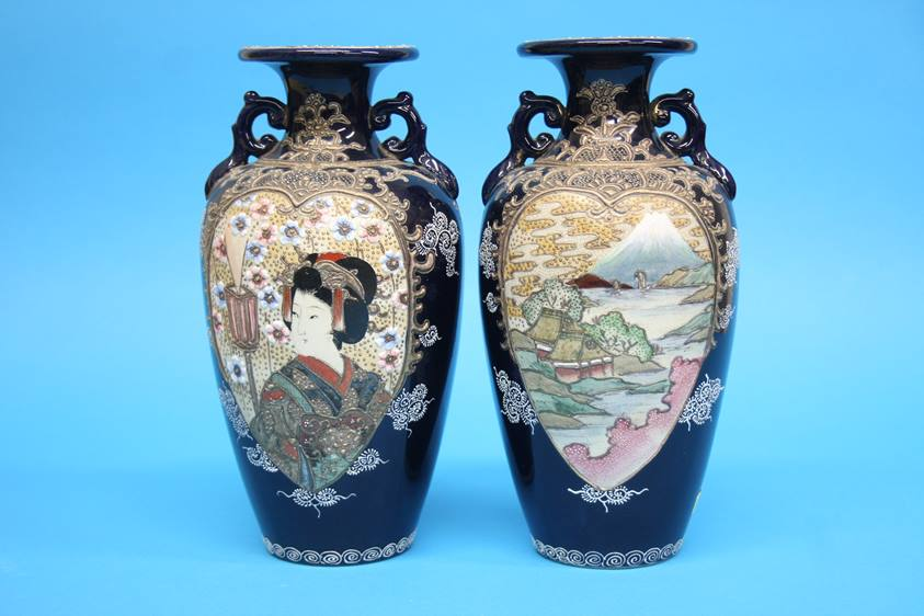 Lot 21 - A pair of 1920/1930's Satsuma vases decorated with panels of landscapes etc. 25cm height